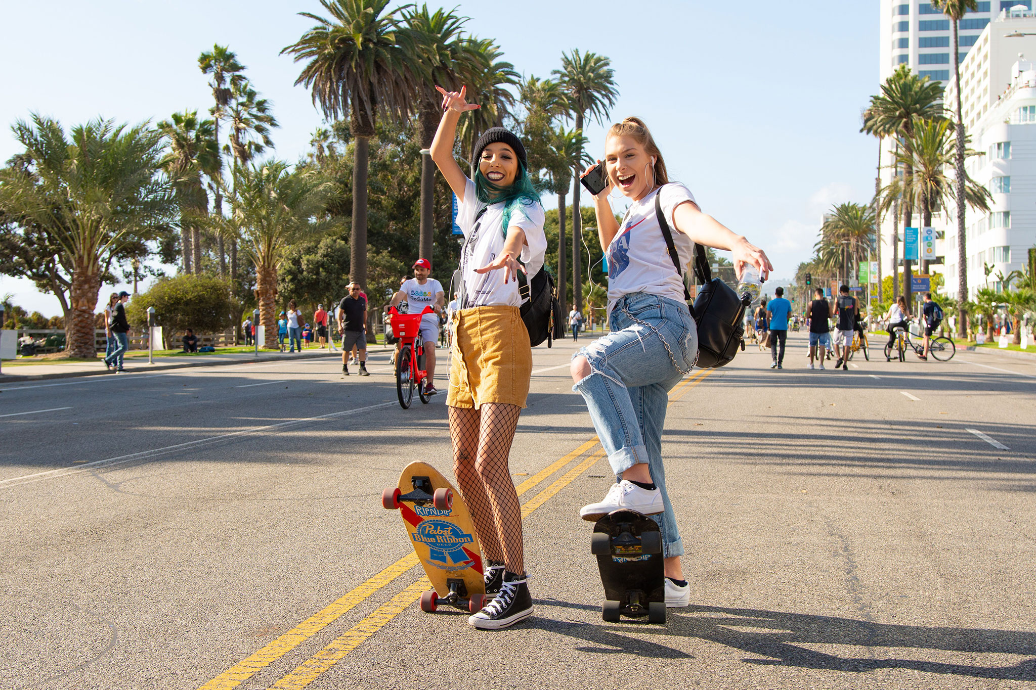 Photo: COAST visitors with skateboards, enjoying an open street with no cars present.